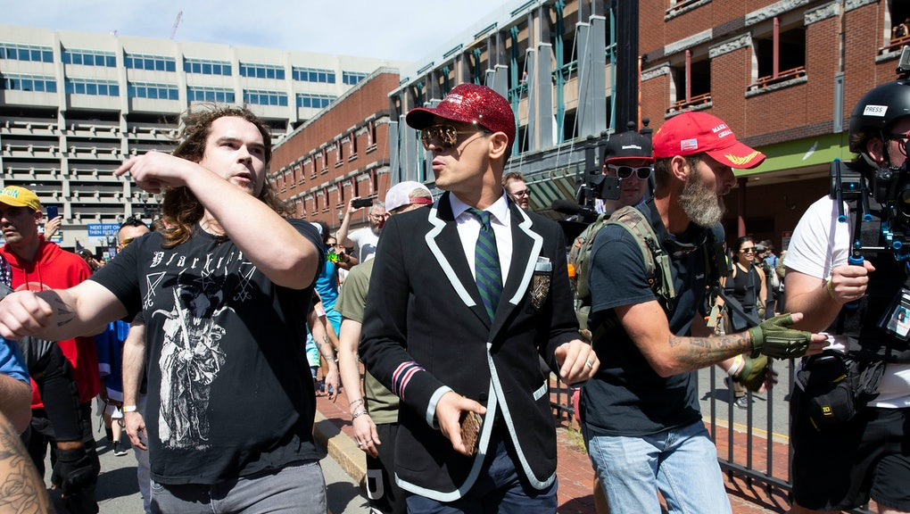 Milo Yiannopoulos (C) is flanked by security as he takes part in the 'Straight Pride Parade' in Boston, Massachusetts, USA, 31 August 2019. Despite outrage from local politicians including Mayor Marty Walsh, the parade was granted permission to march but under a heavy police presence.