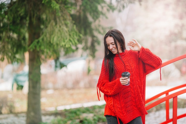 Woman with coffee in the forest on weekend and enjoy the nature