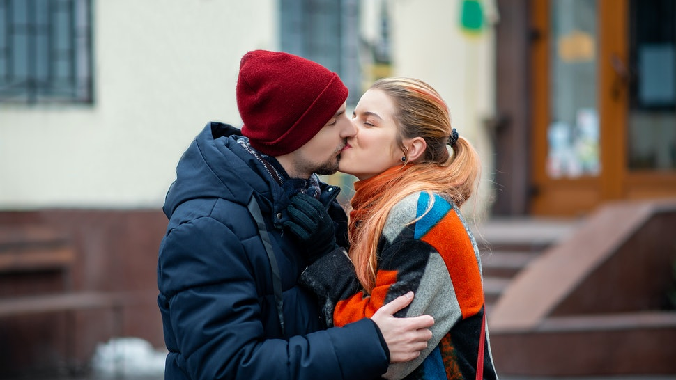 couple kissing outside in spring.