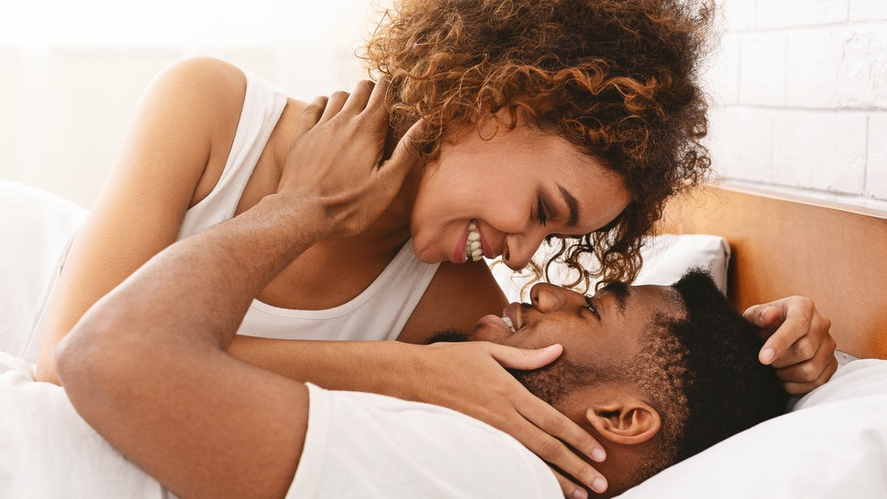 Gentle morning together. Young black couple making love in bed, start day with passion, closeup