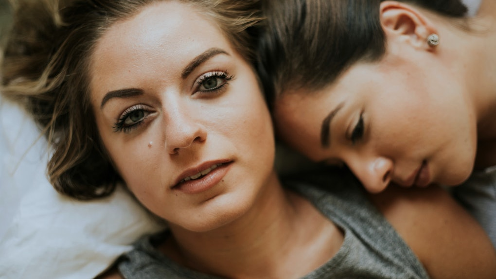 Lesbian couple together in bed