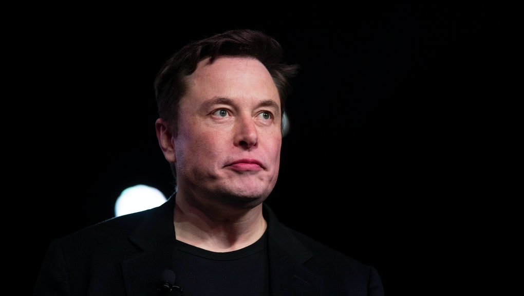Tesla CEO Elon Musk pauses while speaking before unveiling the Model Y at the company's design studio in Hawthorne, Calif. Musk will face the electric car maker's shareholders during the company's annual meeting on Tuesday, June 11