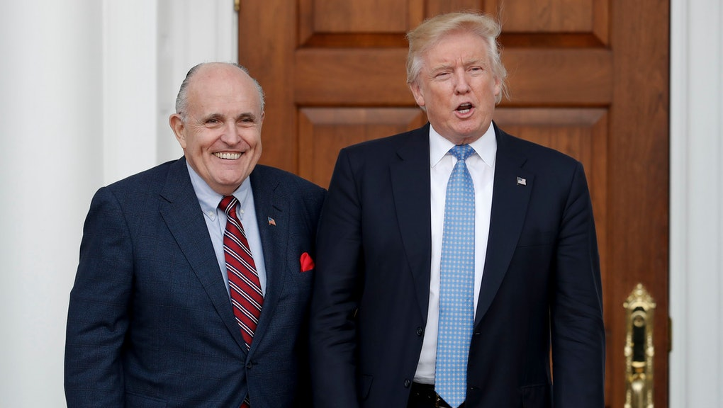 Donald Trump, Rudy Giuliani President-elect Donald Trump, right, and former New York Mayor Rudy Giuliani pose for photographs as Giuliani arrives at the Trump National Golf Club Bedminster clubhouse, in Bedminster, N.J