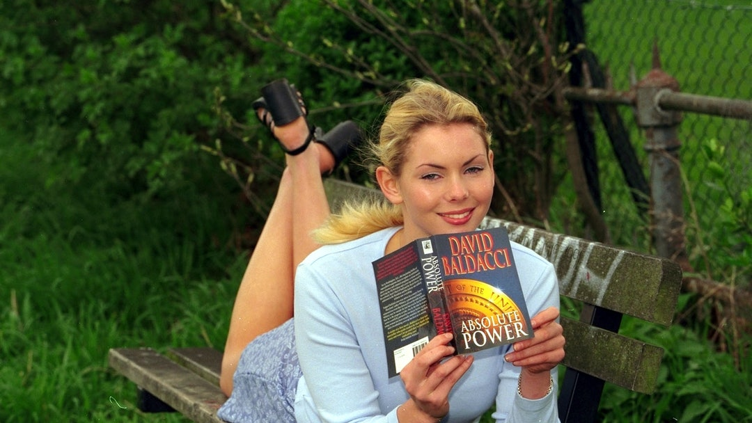 Model Judy Long Poses With The Paperback Of Absolute Power By David Baldacci For A Scottish Daily Mail Promotion.