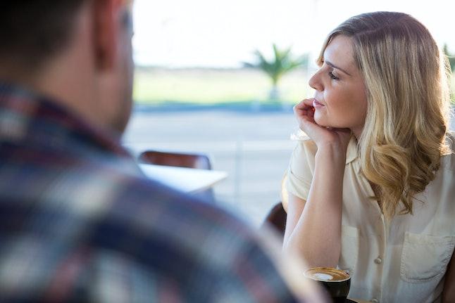Upset woman sitting in coffee shop