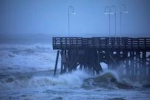 Waves strike the Main Street Pier as Hurricane Dorian passes 90 miles offshore in Daytona Beach, Flo...