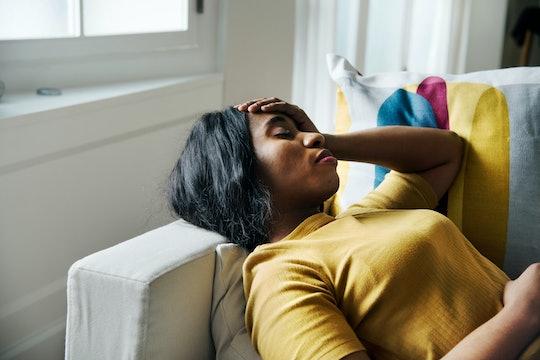 Black woman headache and sleeping
