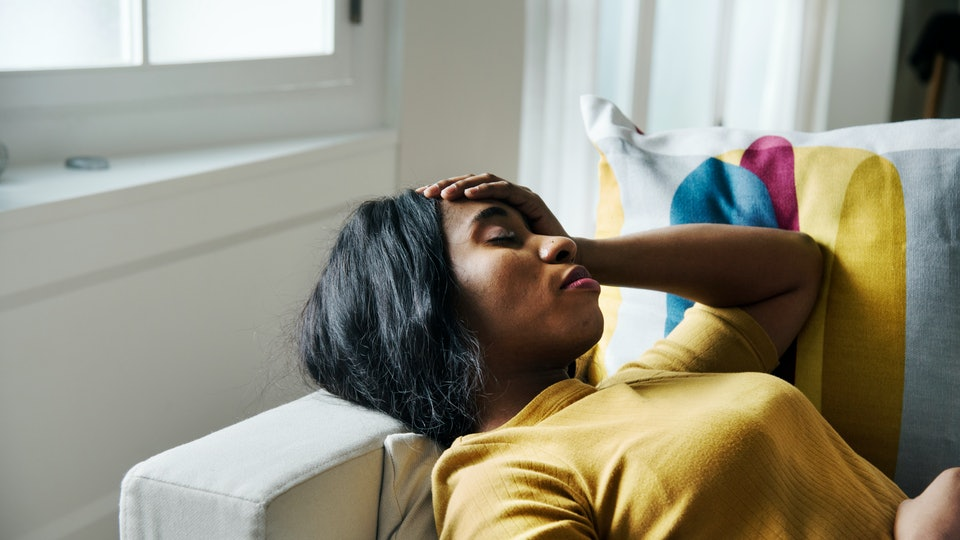 Black woman headache and sleeping