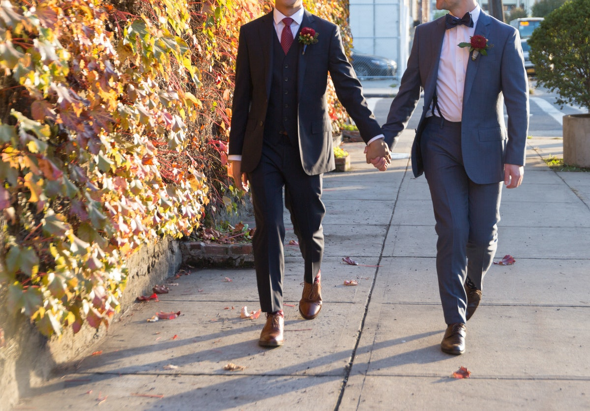 Gay Grooms Walking Together on Wedding Day in Fall