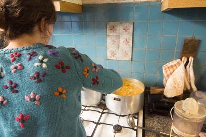 Woman Cooking Andean Locro Stew