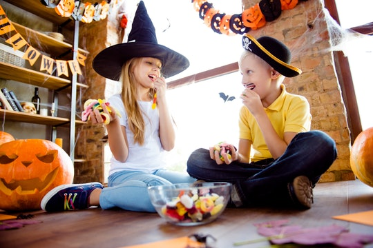 Experts say letting kids enjoy their Halloween candy is better for them than trying to keep sweets a...
