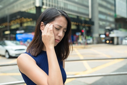 Woman feeling headache