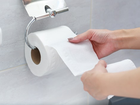 Close-up of Hand Using Toilet Paper.