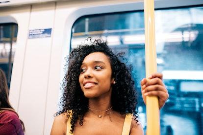 Happy black woman on London underground