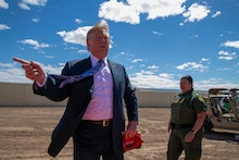 President Donald Trump speaks as he visits a new section of the border wall with Mexico in Calexico,...