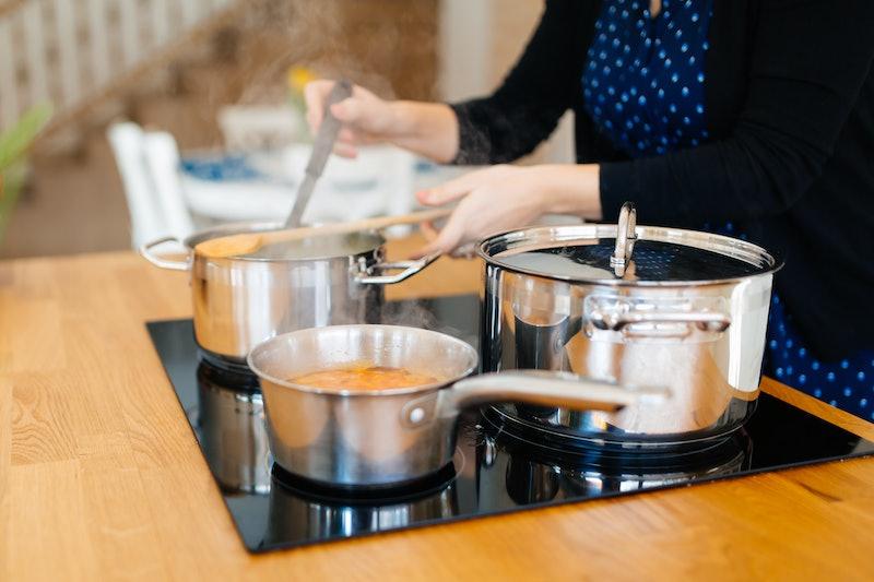 Woman making organic  lunch in modern kitchen