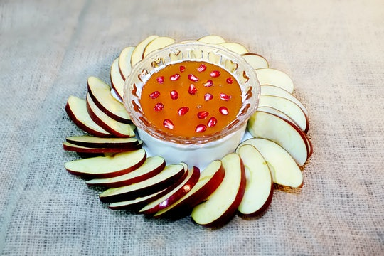 Symbols of the holiday of Rosh Hashanah (Jewish New Year): honey, apple, pomegranate. Tradition Jewish holiday Rosh Hashanah