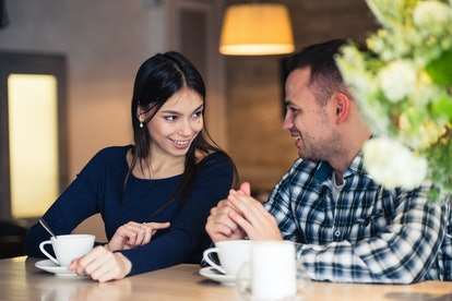 Young couple talking in coffee shop