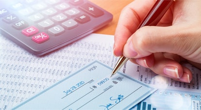 Business man prepare writing a check on background