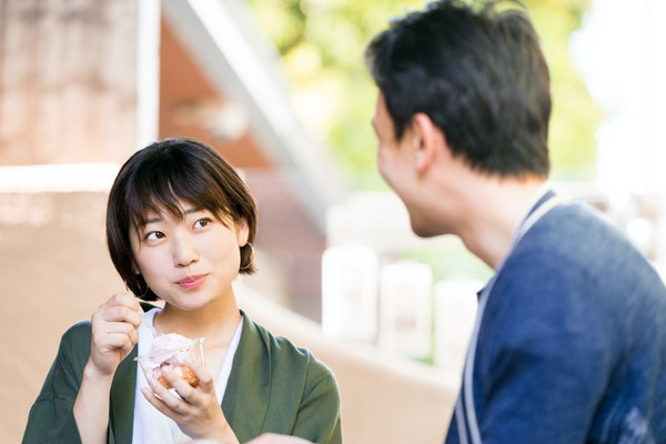 Woman eating ice cream (a date couple)