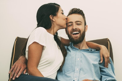 Happy young woman kissing her man passionately