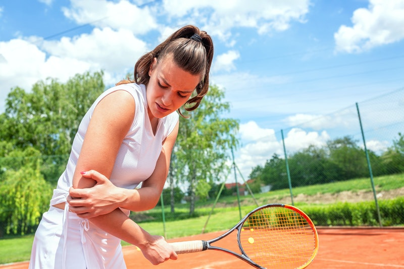 Elbow injury in tennis, unpleasant facial expression, arm injury