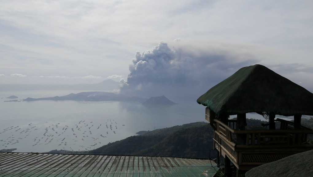Taal volcano continues to erupt in Lemery, Batangas, southern Philippines on . Red-hot lava gushed out of a volcano near the Philippine capital on Monday, as thousands of people fled the area through heavy ash. Experts warned that the eruption could get worse and plans were being made to evacuate hundreds of thousands