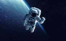 Astronaut at spacewalk. Cosmic art, science fiction wallpaper. Beauty of deep space. Billions of gal...