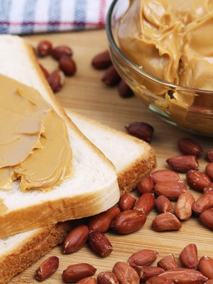 Sandwiches with peanut butter and peanuts