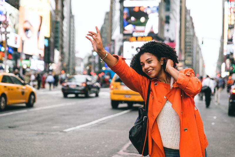 Woman looking for a taxi in New york city