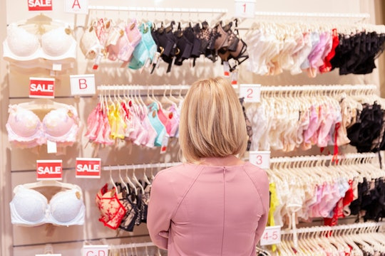 a woman shopping for bras