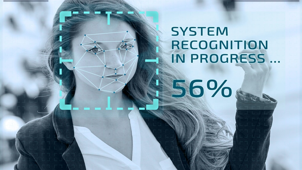 Simulation of a screen of cctv cameras with facial recognition. Facial recognition of a woman in a street