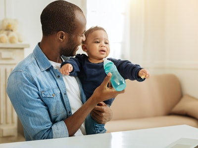 Giving baby a bottle is another way dads can help breastfeeding moms wean their baby.