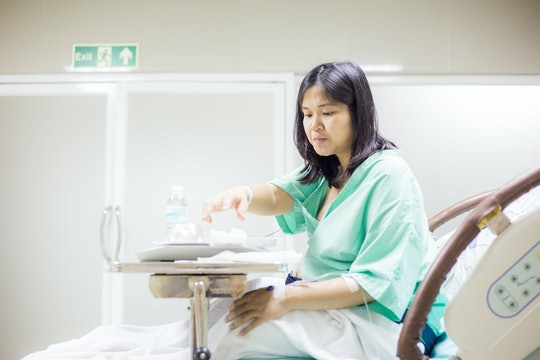 pregnant woman in hospital bed with food