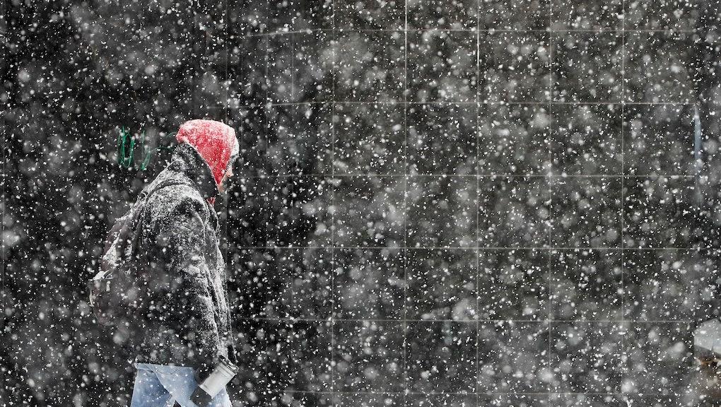 A pedestrian walks during a winter snowstorm in Philadelphia