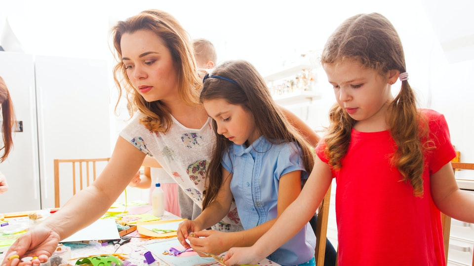 a mom doing crafts with her kids