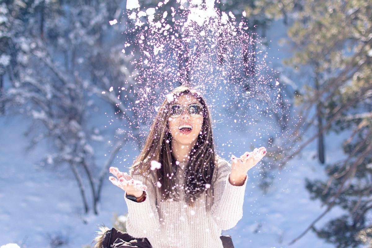 girl having fun in the snow