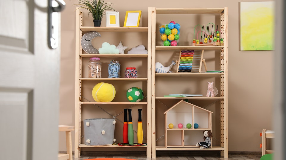 Finding a dedicated space for all of your kids' toys can make a room bright and organized.