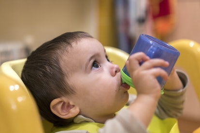 One year old boy drinking out of sippy cup