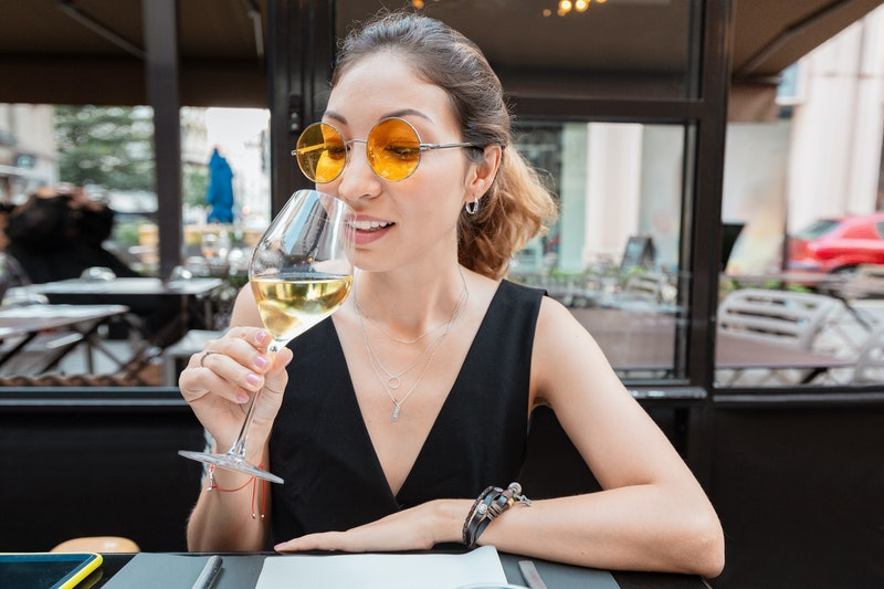 young asian customer woman drinking white wine