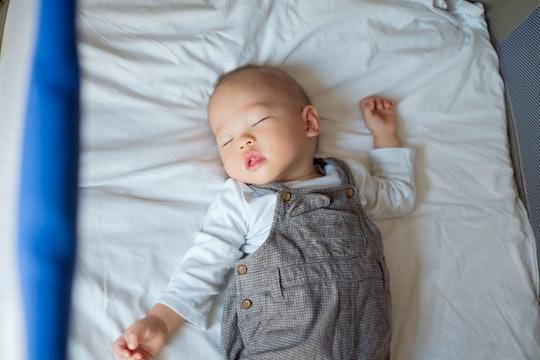 baby boy sleeping in a crib