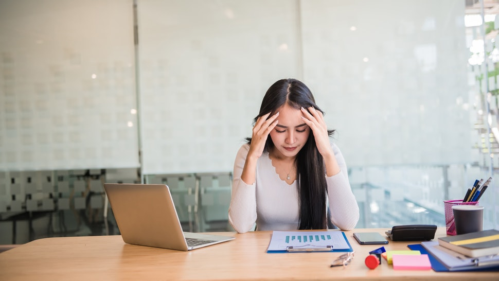 Woman stress at work, office