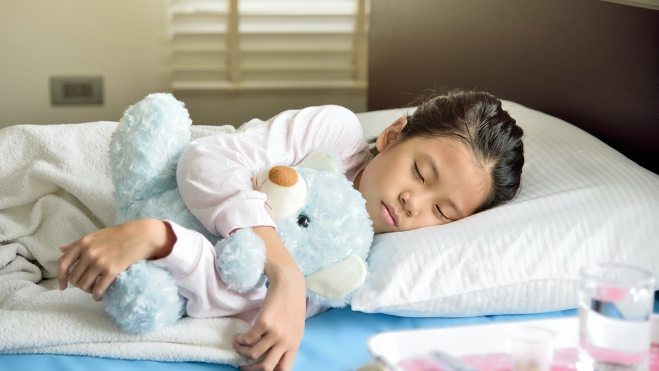 Keeping your children in bed to rest and take medicine will help them heal from the flu.