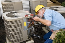 Repairman Works On Air Conditioner Horizontal Shot