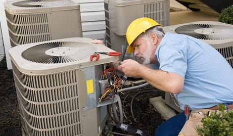 Repairman Works On Air Conditioner Horizontal Shot