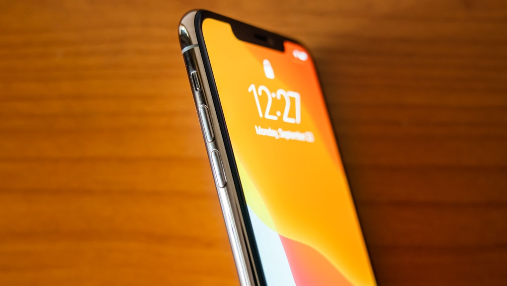 In this photo a new iPhone 11 Pro Max smartphone is seen on a wooden top.