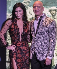 Amazon Founder and CEO Jeff Bezos (R) and his partner, US new anchor Lauren Sanchez (L), poses for p...