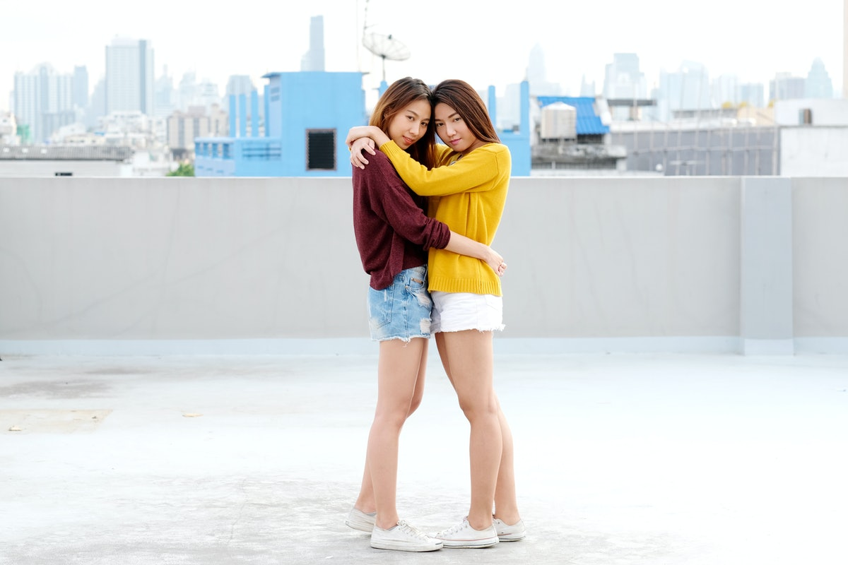 LGBT, Young cute asia lesbian couple huging and smiling with happiness on their dating, homosexual, ...