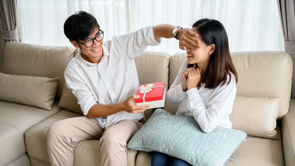 man giving present to woman on special day