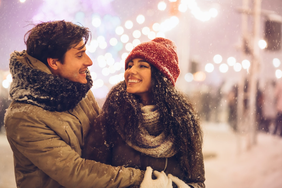 Happy Couple Hugging Celebrating New Year Night Outdoors Standing On A Street Decorated With Winter ...